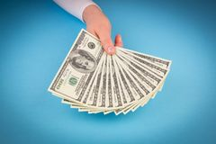Hand holding money dollars Stock Photo