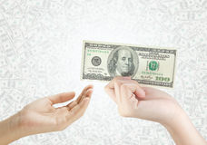 Hand holding money dollars and giving to the other Stock Photo