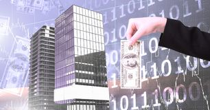 Hand holding money and Tall buildings with binary code scales background. Digital composite of Hand holding money and Tall buildings with binary code scales stock images