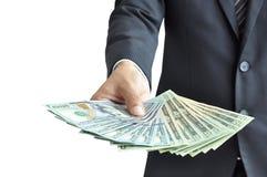 Hand holding money - United States dollar (USD) bills Royalty Free Stock Photography