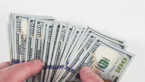 Hand holding money - United States dollar (USD. ) bills. RAW video record stock footage