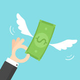 Hand holding money with wings Stock Photography