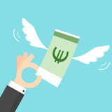Hand holding money with wings Stock Image