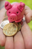 Hand holding moneybox - pink piggy as symbol of savings Stock Photo