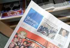 A hand holding Montreal Gazette newspaper. royalty free stock photo