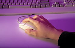 Hand holding mouse and keyboard Stock Images
