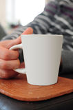Hand holding mug. For coffee or tea Stock Photos