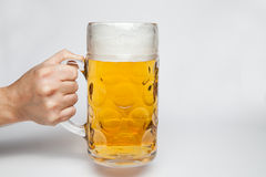 Hand holding a mug of beer royalty free stock photography