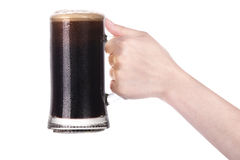 Hand holding mug of beer isolated.making toast Royalty Free Stock Photos