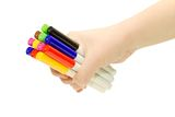 Hand holding multicolored markers. Isolated. Royalty Free Stock Photography