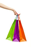 Hand holding multicolored paper bags Stock Photo
