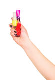 Hand holding nail polish Royalty Free Stock Image