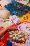 Hand holding nanduti at the street market in Asuncion, Paraguay Stock Image