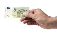 Hand holding new five Euro bill Royalty Free Stock Images