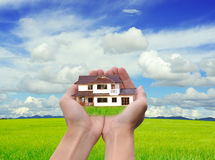 Hand holding new house Royalty Free Stock Image