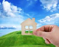 Hand holding new house Stock Images