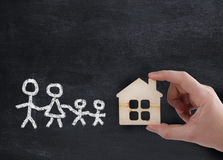 Hand holding new house for family Stock Photo