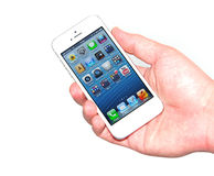 Hand holding new iPhone 5 Stock Photography