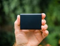 Hand holding new SSD external disk drive royalty free stock photography