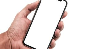 Hand holding, New version of black slim smartphone similar to iphone x royalty free stock images