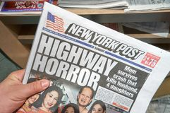 A hand holding The New York Post newspaper. stock photography