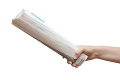 Hand holding a newspaper Royalty Free Stock Photo
