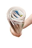 Hand holding a newspaper Stock Images