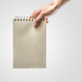 Hand holding notebook Stock Image