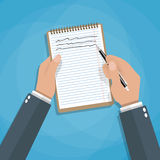 Hand holding notebook and pen stock illustration