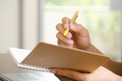 Hand holding notebook and pen Royalty Free Stock Photo