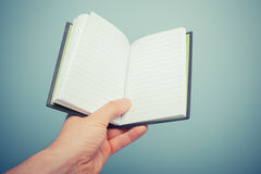 Hand holding notebook Royalty Free Stock Photo