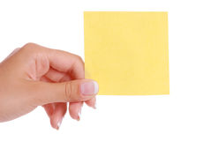 Hand holding notepaper Stock Photo