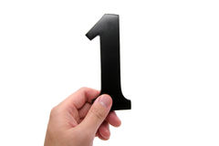 Hand holding number 1 Royalty Free Stock Images