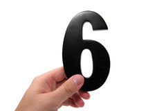 Hand holding number 6. With white background stock images