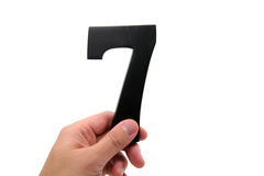 Hand holding number 7. With white background royalty free stock photo
