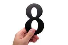 Hand holding number 8 Royalty Free Stock Image