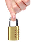 Hand holding number combination lock. On white background Stock Images