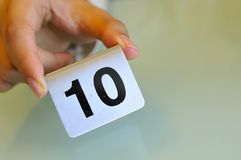 Hand Holding Number Tag Royalty Free Stock Photo