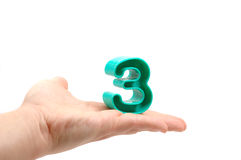 Hand holding  number three. Hand holding a toy number three Royalty Free Stock Photo