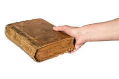 Hand holding an old book  on white background Royalty Free Stock Images