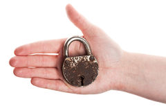Hand holding old padlock Stock Images