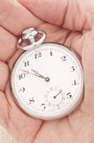 Hand holding an old pocket watch Royalty Free Stock Image