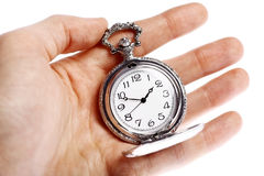 Hand holding old pocket watch Stock Photo
