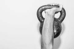 A hand holding old and rusty kettle bell Royalty Free Stock Photos