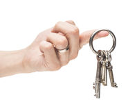 Hand holding old skeleton keys Stock Photos