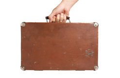 Hand holding an old suitcase Royalty Free Stock Image