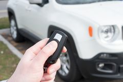Hand holding one car alarm key with anti-theft. Hand holding a car alarm key with anti-theft stock images