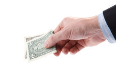 Hand holding a one dollar bill. Royalty Free Stock Photo