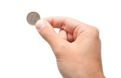 Hand holding a one euro coin. A hand keeping an euro coin Stock Photography