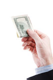 Hand holding a one hundred dollar bill. Royalty Free Stock Photo